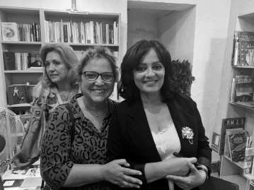Juana Ríos junto a Mayda Bustamante, editora de Huso
